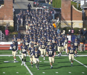 Juniata, The Alma Mater, comes down the street from the Kennedy Center on campus to take the field at Chuck Knox Stadium!