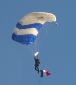 The Air Force Academy's Wings of Blue Sky Diving team honors and mourns France in its pre-game parachuting ceremony.