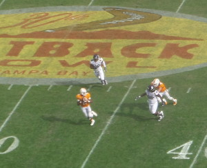 QB Joshua Dobbs rolls out to pass in the third period.