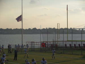 At the 2014 D3 Mass Maritime vs. SUNY Maritime game in Throggs Neck, NY, first responders and military were honored at the 9/11 game with the new Freedom Tower seen high above New York City a few miles away.