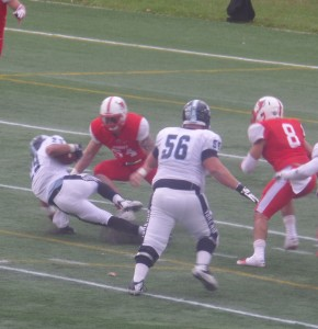 Marist LBs Jimmy Braun (54) and Ruben Avalos (8) move in for stop near the goal line.