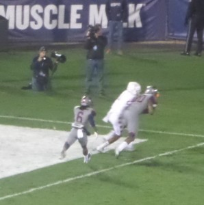 UConn Safety Obi Melifonwu (20) nabs a Temple Owl pass in the end zone to turn the ball over.