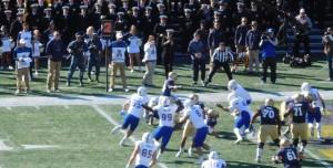 Navy Midshipman RB Dishan Romine carries the ball toward Navy goal line.