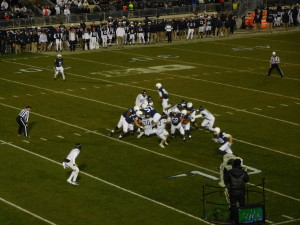 LT Ryan Bates (52) leads the charge for the Nittany Lion running game.
